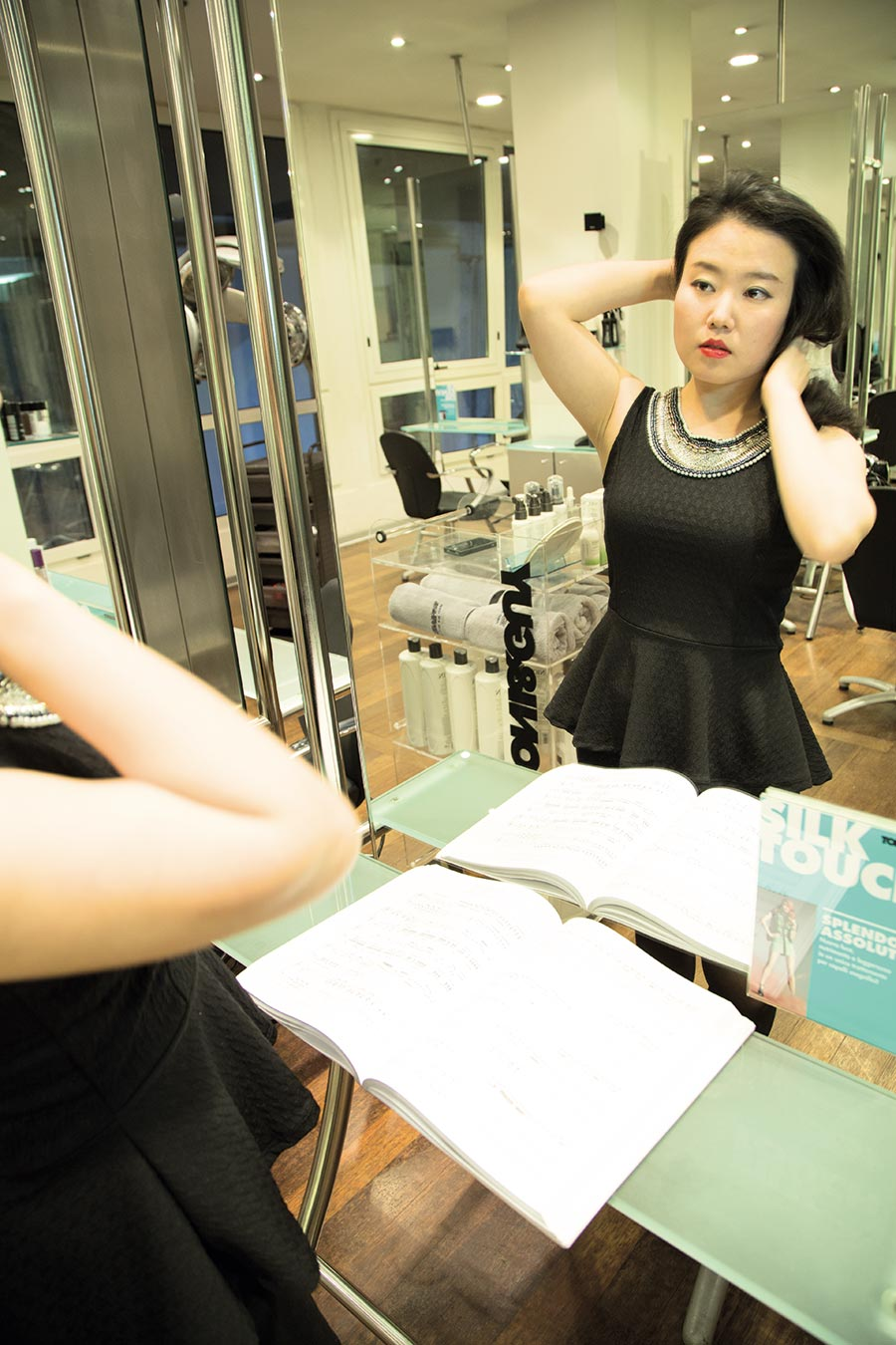 Jiyeong Son is posing in front of the mirror at the Tony&Guy hair salon, in Milan. Photos by Max Di Vincenzo, Milan, Italy